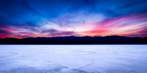 Salt polygons in Death Valley's Badwater Basin under a brilliant sunset sky