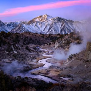 Hot springs send steam into the air on a chilly morning as sunrise begins to light up Laurel Mountain in California's Easter Sierra.