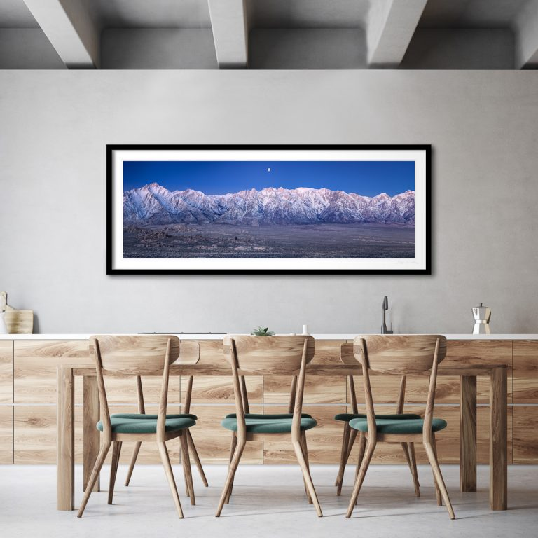 A 24x60-inch framed print of Moonset Over the Eastern Sierra decorating a corporate breakroom.