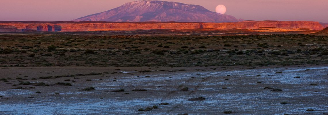 The full moon rises over Navajo Mountain in southern Utah